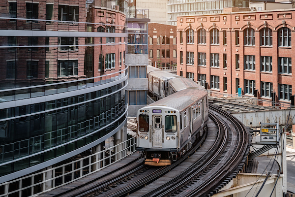 A Chicago L Train turns the corner at Merchandize Mart, where Regroup CEO David Cohn is speaking