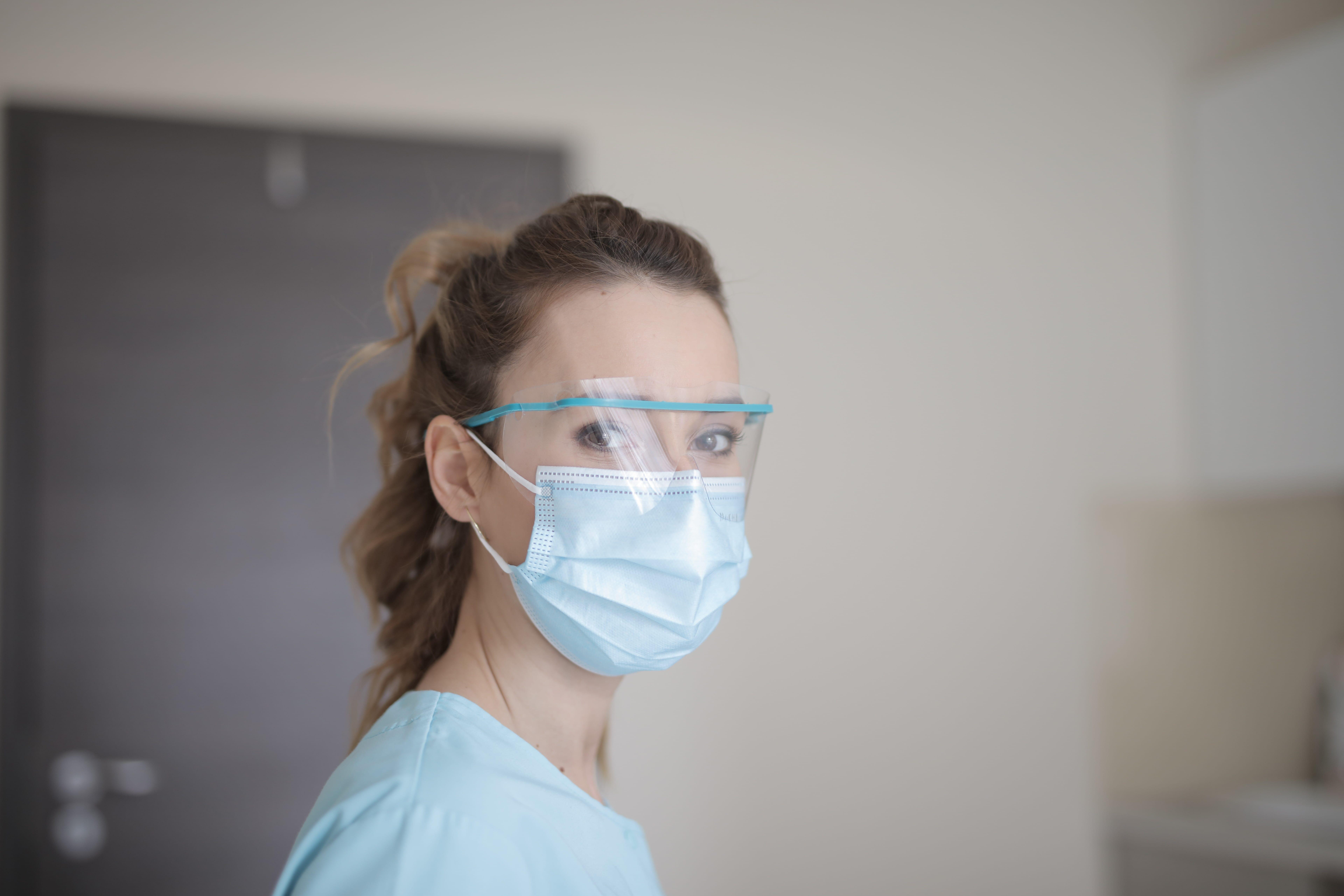 woman-in-blue-shirt-wearing-face-mask-min